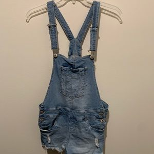 Medium-wash, lightly distressed overalls